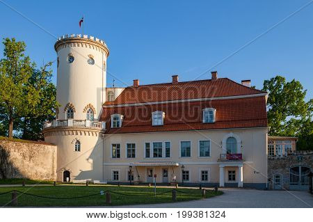 New white castle in old town of Cesis, Latvia. Part of ancient Livonian castle ruins. Greenery and summer daytime.