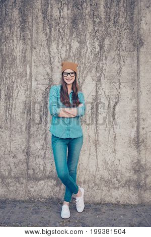 Full Length Of Excited Girl, Standing On The Concrete Wall`s Background Outdoors, Smiling, With Cros