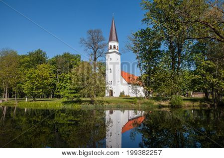 Lutheran Church of St. Berthold with reflection in the pond. Sigulda, Latvia.