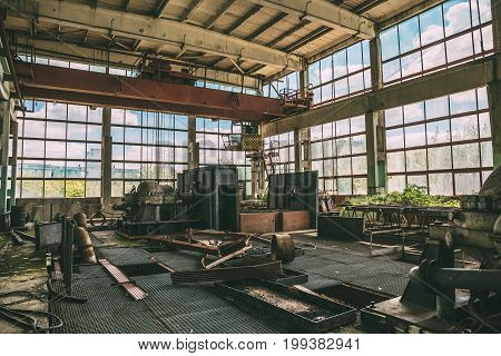 Large abandoned factory inside interior, large workshop with equipment