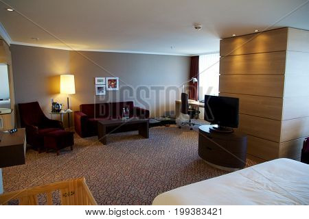 MAINZ, GERMANY - JUL 7th, 2017: Luxury and nicely decorated living set, lunch room with the table with the coffee, tea set and the living suite, room and a desk aside. Perfect Interior design