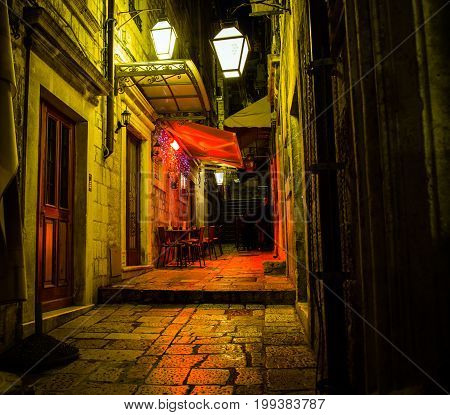 Red light above an outdoor cafe in Dubrovnik