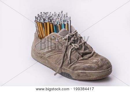 Old wear out shoe stock with lot of pens