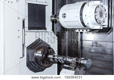 Closeup shot of the machine tool in factory hall.