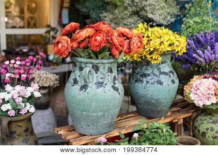 Beautiful artificial flowers in delicate vase