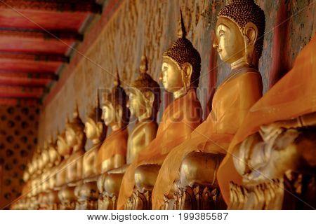 Row Of Golden Buddha Statue At Wat Arun, Bangkok Thailand. Landmark Of Thailand And Asia