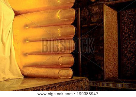 Golden Foot Is Part Of Huge Reclining Buddha Statue In A Famous Temple In  Bangkok , Thailand