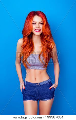 Young Sexy Foxy In Summer Outfit On Bright Blue Background. So Playful, Seductive! Standing And Smil