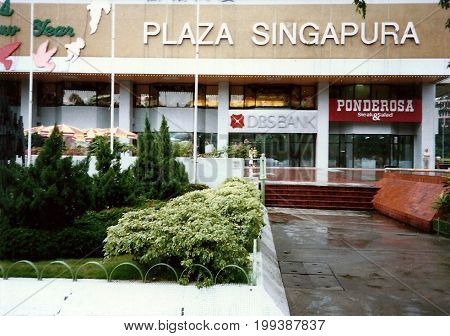 SINGAPORE - CIRCA DECEMBER, 1990: One may eat steak and salad at the Ponderosa Restaurant in the Plaza Singapura shopping mall, which is decorated for Christmas.