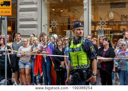 Stockholm, Sweden - August 05, 2017: Pride 2017 In Stockholm. The Policeman Takes Care Of The Order
