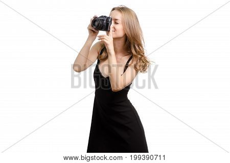 Young woman with an old camera on a white background isolated