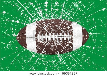 A typical american type foorball with grunge over a green background