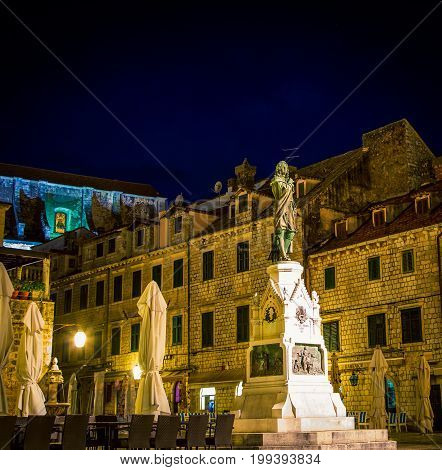 Night scene of a statue and square in Dubrovnik