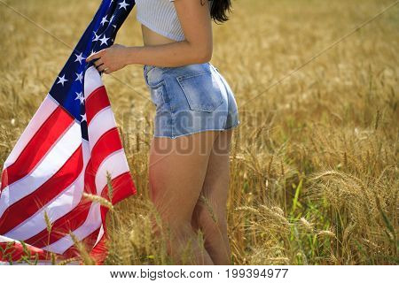Body part, blue jeans and american flag