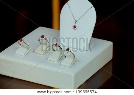Classic Diamond engagement rings in a shop window red ruby with diamond halo poster