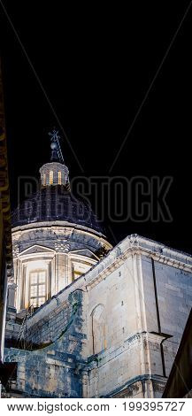 The glow of a church dome at night in Dubrovnik