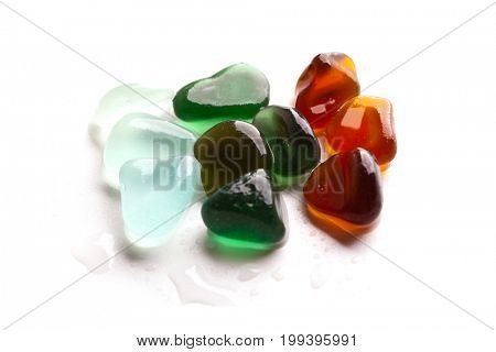 hip of green, blue and brown wet pieces of glass polished by the sea isolated on white background