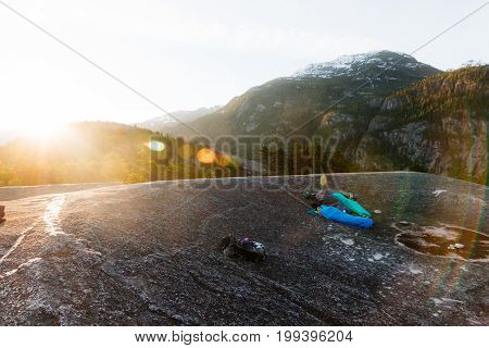 People Sleeping On The Top Of Mountains While Sunrise
