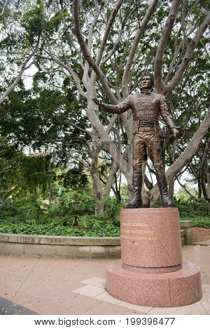 SYDNEY,NSW,AUSTRALIA-NOVEMBER 19,2016: Major General Lachlan Macquarie statue with lush fig trees at Hyde Park in Sydney, Australia