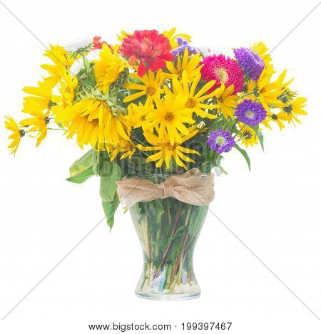 Bright fall bouquet in glass vase isolated on white background