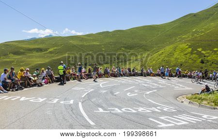 Col de PeyresourdeFrance- July 23 2014: Cycling fans are waiting for the peloton the side of the road to Col de Peyresourde in Pyrenees Mountains during the stage 17 of Le Tour de France on 23 July 2014.