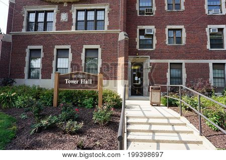 JOLIET, ILLINOIS / UNITED STATES - JULY 17, 2017: Stairs lead to an entrance to Tower Hall at the University of Saint Francis.