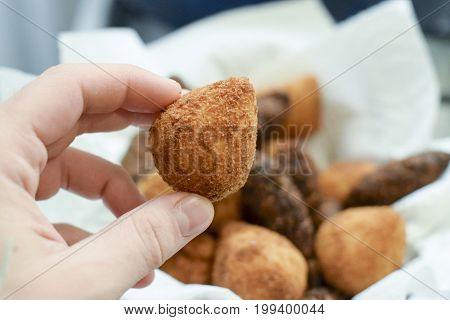 Hand Holding Deep Fried Brazilian Coxinha Chicken Croquette
