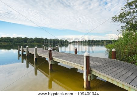 Fishing pier and boat launch in Bayview Park on Bayou Texar in Pensacola Florida in early morning light