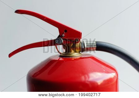 red fire extinguisher on white background .