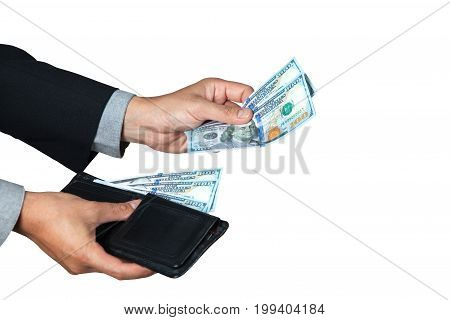 The businessman took dollar out of his wallet for pay or donation with white background and space for copy.