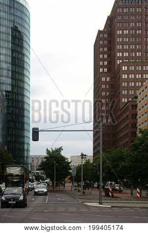 BERLIN, GERMANY - JUNE 21: Traffic in front of the modern glass facades of the Sony Center and the DB skyscraper on June 21, 2016 in Berlin.