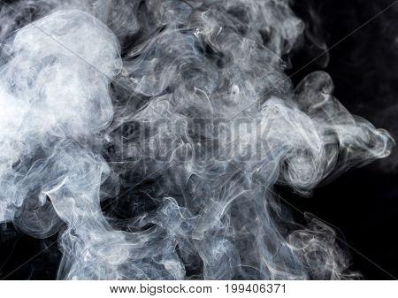 green smoke on a black background . Photo texture