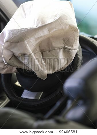 Car interior with the opened air bag