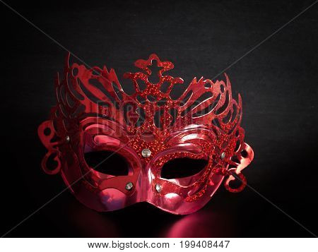 Red mask Placed on a Black background.