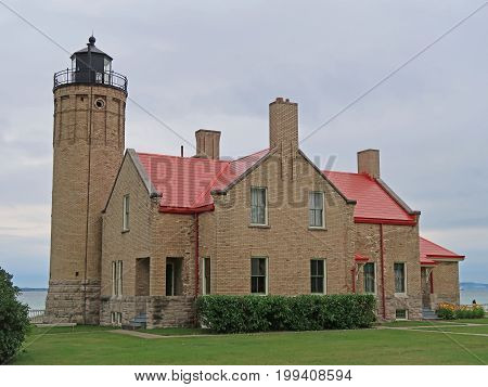 The Mackinac Point Lighthouse in Mackinaw City, Michigan began operation in 1892 to aid ships sailing through the difficult turning point in the Straits of Mackinac, which joins Lake Michigan and Lake Huron.