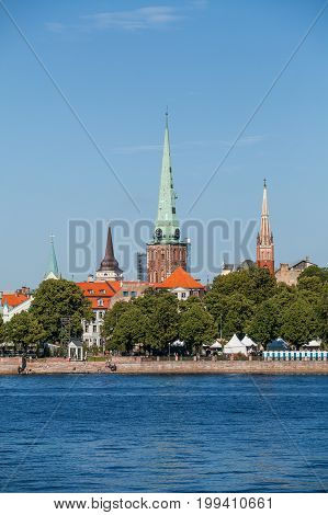 Summer day view on churches of Riga old town with Daugava river