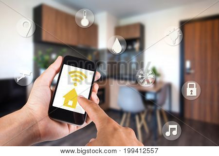 Hand Using Smartphone By App Smart Home On Mobile For Remote Control Everything In Home By Wifi Netw