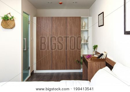 Wardrobe Built In And Desk Wooden On The Bedroom With Toilet In Side In Condominium.