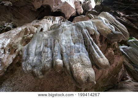 Writing on stone in cave by unconscious human.