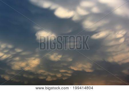 Wavy hilly dark clouds on the sky kind undulatus asperatus