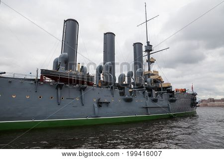 SAINT PETERSBURG, RUSSIA - 16 JUL 2016: Cruiser Aurora is returning to the pier, Neva river