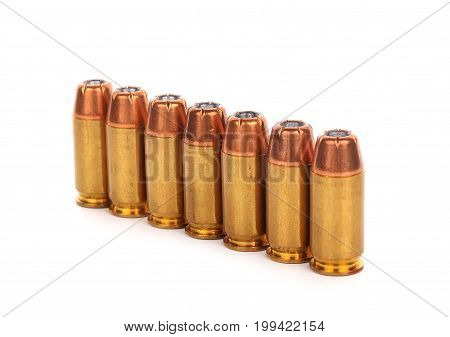 cartridges of .45 inch or 11mm pistols ammo bullets on white background