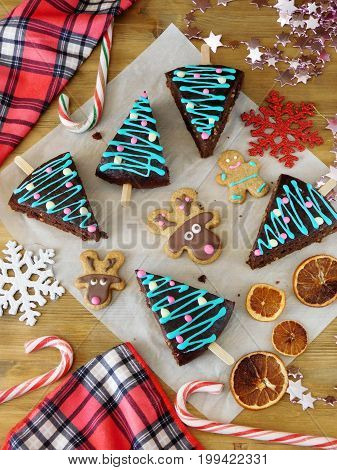 Christmas pastry, candies and decorations. Cakes decorated as Christmas trees. New year and Christmas composition