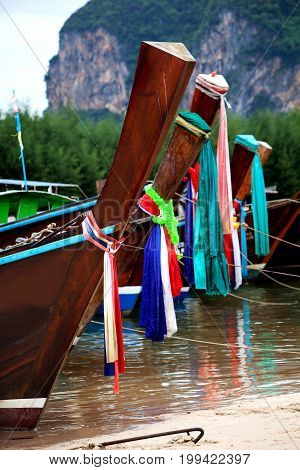 Colorful Cloth Tied On Head Of Fishing Boat Is Belief Of Fishermen In Thailand.