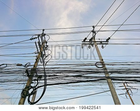 The electric poles supporting wires for various public utilities such as drop wire cable or fiber optic cable