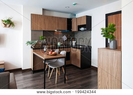 Corner Kitchen With Dining Table In The Room Condominium.