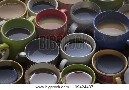 coffee time - lots of coffee cup in different cups. coffee lover - many cups of coffee on wooden table good background for text or graphic design