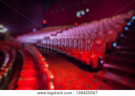 Blurry Background Of Red Seat In The Movie Theater.