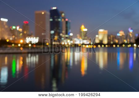 Reflection blurred light city building night view abstract background