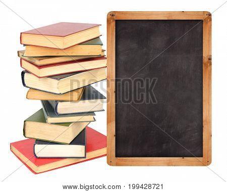 Stack of  books with school blackboard